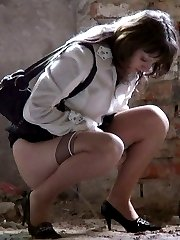 Girl pulls her pantyhose and panties down to piss