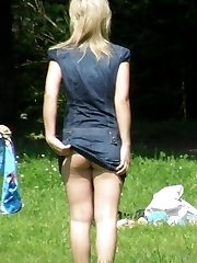A pantyhosed lady in outdoor upskirt pictures