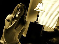 Sensuous blonde smokes a cigarette and blows a long shaft t