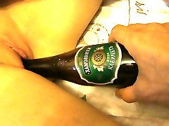 Beer bottle insertion in dreaming wife's pussy