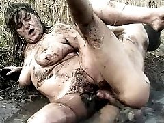 Blonde fat granny fucked hard in the mud
