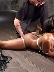 We begin with Chanell on the floor with her legs spread wide, her upper arms bound to her body...