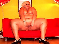 Hefty Melinda Shy does a striptease to show off her enormous fat backside and titties