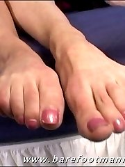 Sexy young brunette sucks her own toes before taking a cock deep in her pussy