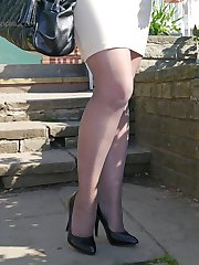 Sexy Sara teases her beautiful nylon legs and tall black stilettos outoors