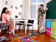 Olya and her sexy young classmate come into their teachers classroom after class to receive the...