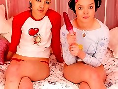 Two appealing teen lesbians licking their wet beavers in 69 position