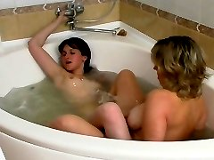 Mature chick joins a sexy girl in bubble bath getting to wet lesbian games
