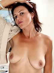 Hairy housewife Ava Austin exposes her big natural breasts.