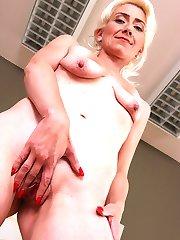 Older mature babe Janotova exposes shaved pussy.