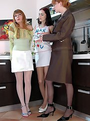 Hot lezzies in smooth colored pantyhose having strap-on fun in the kitchen