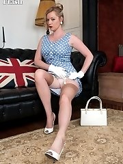 Holly stripping off her chic dress and parading in her vintage nylons!