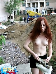 Construction workers watch a sexy girlie flashing