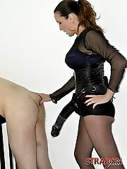 Strapon Jane fucks her submissives face with her strapon before unleashing the big gun on his tight ass