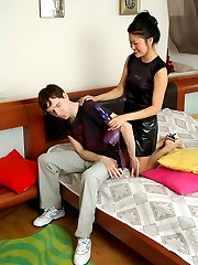 Nasty Asian babe greeting her lewd boyfriend with ready to action strap-on