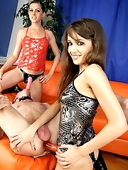 Two girls put their strapons and play with cocks to fuck a slave