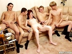 Pretty redhead in hardcore group sex