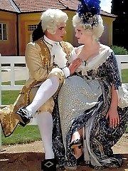 Costumed couple screw in the garden