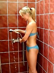 Slim blonde with nice pink tits taking a shower!