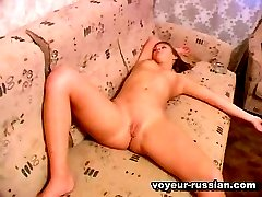 Sexy tanned brunettefilmed on a hidden cam while drowsing with legs spread