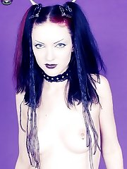 Classic Gothic girl shows her pale skin body
