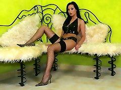 Beauty brunette in tight black latex
