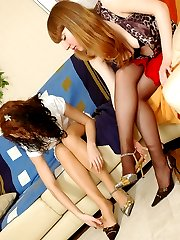 Lesbian chicks taking turn in tongue-tickling their feet in sheer pantyhose
