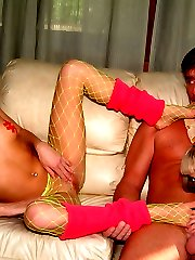 Two skinny girls give dude footjobs and blowjobs while he worships their asses and feet