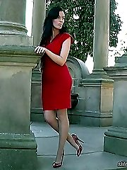 Tricias red high heels are really high and they will make you stiff with desire until your hot...