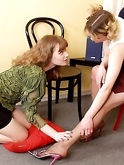 Cuties dancing before petting each other with their feet clad in pantyhose