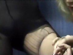 Teen rams a huge dildo between her stockinged hips