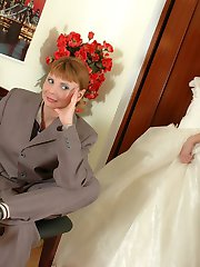Two girls dressed as bride and bridegroom go for wet role play in stockings