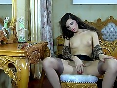 Horny brunette in classy tan nylons sucks and shoves her toy up the brown