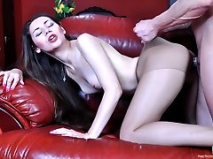 Pantyhose clad sexpot straddles the face and shaft of a horny muscled stud