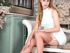 Lucy has been shopping for vintage nylons on a trip in mint green dress and white stilettos.