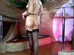 Foxy brunette puts on a new pair of black stockings with a hot lacy girdle