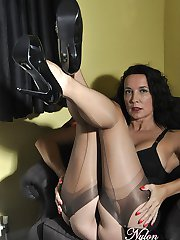 Hot Milf Nylon Jane shows off her curves in her sexy nylon stockings, black lingerie and matching high heel shoes