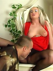 Busty babe in a red dress and black pantyhose gets it on with a nylon junky