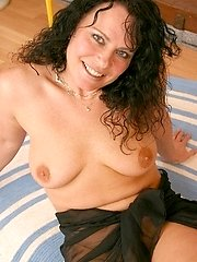 Black-haired mom Angeline shows off her body