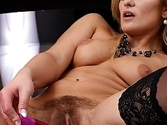 Horny older babe Samantha Snow dildos hairy pussy.
