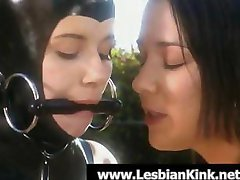 Lesbian slave in latex and bound is taken outside for punishment