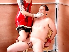 Goddess Soma is very skilled in flogging. She has her slave bound to a chair, legs spread open...
