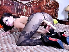 Killer looking brunette adores her flower design hose and solo dildo play