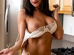 Busty MILF Mackenzie Marie strips naked in kitchen.