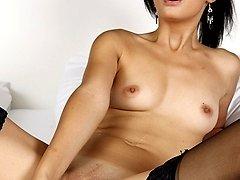 Gorgeous MILF Erica Fox dildos her juicy tight pussy.