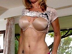 Busty cougar Jenna Covelli masturbates with dildo.