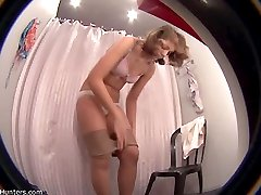 Cutie undresses and tries on a bikini in voyeur clips