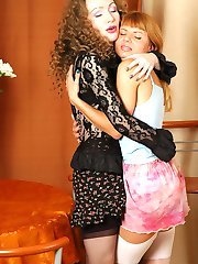 Heated mature lesbo fondling a shy sweet thing teaching her use her tongue