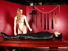 Femdom Elle has her slave in a confusing position. He is inside a leather sleep sack while...