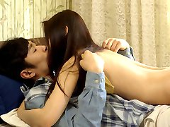 Asian couple in bedroom